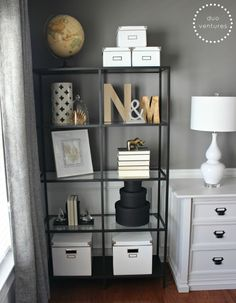 Mixing metals on the bookcases, i.e. golds, silvers, blacks, and whites -- initials