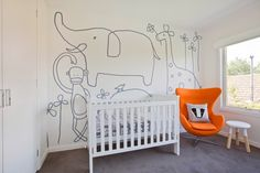 The Zoo - Cute grey elephants, monkeys and skunks with a pop of tangerine orange for the baby boys bedroom. Childrens nursery interior designs by Little Liberty