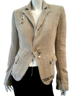 Norio Nakanishi's Singlebreasted jacket with 1 button, flap pockets, stitching in clashing colour. Price $623.00