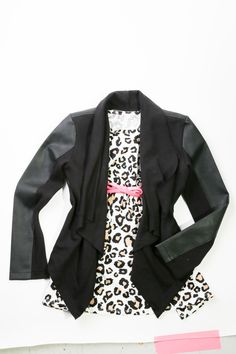 Black pleather cardigan, $39.95 with a tan dress with bright pink bow belt, $29.95 at The Children's Place.