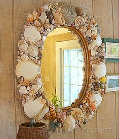 I love this mirror.....gonna be collecting shells for this project!