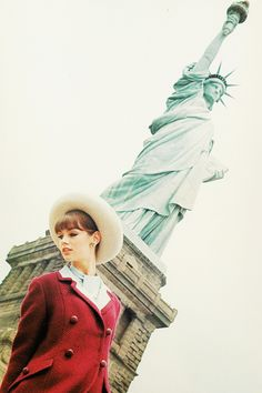 Jean Shrimpton posing in front of the Statue of liberty in New York for Glamour Magazine, 1963.