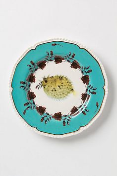 Vintage-inspired curves and flora are centred by an unexpected dinner guest. An Anthropologie collaboration with artist Lou Rota. Plates And Bowls, Plates On Wall, Plate Wall, Ceramic Plates, Decorative Plates, Ceramic Art, Kitsch, Dessert Design, Design Plat