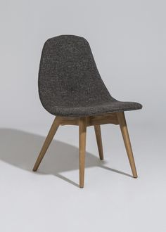 TheJane Side Chair uses bent plywood with an upholstered seat. Available…