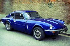 Triumph GT6 Mk III, the Mk II had the bumper mid-grill (bone in teeth) My third one was this type, but mine was orange.