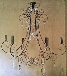 Make a chandelier out of hangers candelabro feito de cabides might b nicer with different type - Unusual uses for wire coat hangers ...
