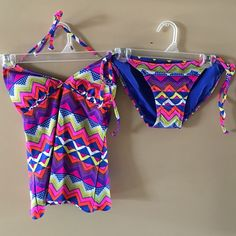Old Navy two piece New with tags. Top ties around neck. Top is padded. Bottoms tie at hips. Old Navy Swim