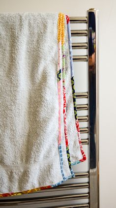 Are your towels looking a little tired, frayed around the edges? Learn how to update them with scrap fabric bias binding.
