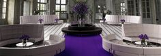 Purple floors and florals are great accents for CORT Event Furnishings. | cortevents.com