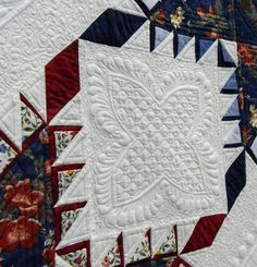 A Truly Feathered Star, detail, by Karen Sievert. World Quilt Show - Florida 2012.  Photo by Jackie Kirner