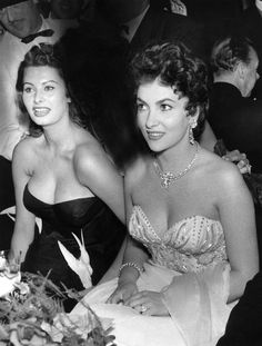 Sophia Loren and Gina Lollobrigida at a film ball in Berlin, 1954.