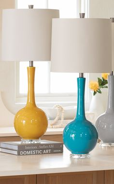 Super-clean, glossily well-colored, and gently modern, our Olivia Table Lamp is one of the easiest pieces to bring into your home.