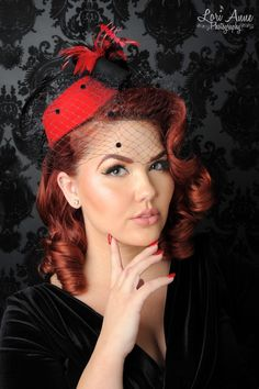 Vintage Style Mini Pill Box Hat in Red - Such a smart accent to a retro style, this wool pillbox hat has a nice flourish of red and black feathers, a wool accent, and a velvet dotted veil.  We're crazy about those velvet dots!!  Attached to an elastic band for ease of wear.