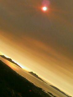 SUNSET VIGO WITH SKY FULL OF SMOKE