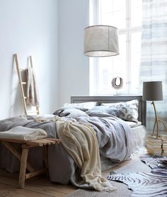 I really like the idea of a ladder near the bed to hang cozy blankets (and PJs)!