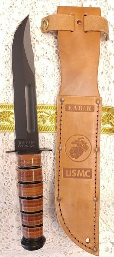 World War 2 style KA-BAR USMC Classic Stacked Leather Grip fixed blade military combat knife with stamped leather sheath
