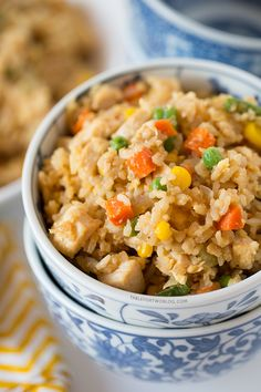 Take-out, fake-out chicken fried rice is so easy to whip up yourself that you won't need to call for take-out! Recipe on tablefortwoblog.com