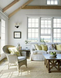 love the colors and the effortless feel of the slipcover couch and whicker chair....blues & tans