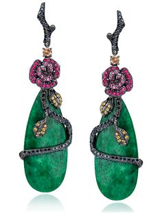 Magenta and pink sapphire rose with brown diamond leaves on a black diamond pavé branch, wraps around elongated green jade; in 18-karat black gold. Brown and Black Diamond weight: approximately 1.40 carats total; Pink Sapphire weight: approximately 1.01 carat total.