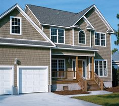 Add value to your home's exterior with the authentic textures of cedar shakes from ProVia's Timberbay vinyl siding.