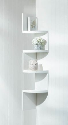 Don't waste that corner space! This sleek corner shelf unit is a functional work of art, with four shelves perfect for displaying collectibles. Available in: White & Black: Weight: pounds Dimensions: x x 51 inches tall Material: MDF wood Corner Shelf Unit, Corner Wall Shelves, Small Shelves, Floating Shelves, Glass Shelves, White Corner Shelf, White Shelves, Display Shelves, Rack Design