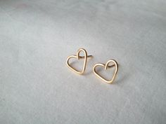 Awesome idea!  Stud earrings made only with 1 piece of wire!  Gold Heart Studded Earrings by NiaBandSags on Etsy, $5.00