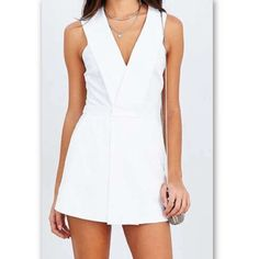 Urban Outfitters White Romper Playsuit Dress This low cut v neck romper/dress combo is in mint condition; worn once on New Years! Urban Outfitters Dresses