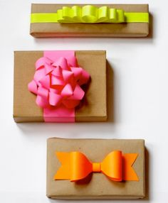 These bright neon gift bows are perfect for dressing up brown butcher paper.