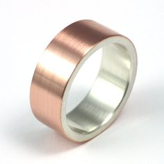 Rose gold with silver inside.