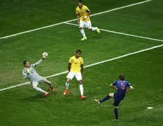 Daley Blind of the Netherlands scores past Brazil's goalkeeper Julio Cesar during their 2014 World Cup third-place playoff at the Brasilia national stadium in Brasilia July 12, 2014.