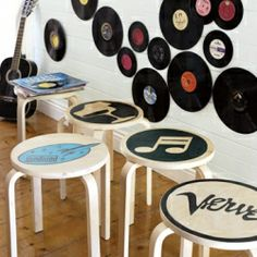 Add pop to plain wooden stools with transfer-and-paint stencils.... Also, Vinyls on walls are just too cool