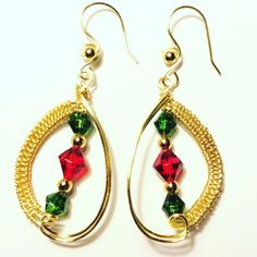 Gold earrings with wire weave on one side, the center has bicone beads in red and green and gold round beads. The wire in gold plate non tarnish. Ear hooks also gold wire. Gold Earrings, Drop Earrings, Christmas Earrings, Wire Weaving, Gold Wire, Christmas Colors, Round Beads, Green And Gold, Weave