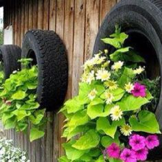 got some old tires on hand here have some garden ideas share with you you can easy build a tire garden keep it simple with a small stack or get creative - Garden Ideas Using Old Tires