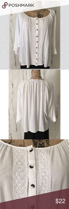 "White Boho Style Blouse with Lace Trim White blouse with lace detail.    Relaxed fit, flowy design  Length: 24"", Chest: 22""  Top material: 100% Viscose,         Trim material: 100% Cotton Tops Blouses"