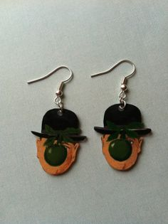 """Hand drawn """"Son of Man"""" Rene Magritte earrings by Courtney Cox"""