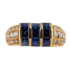Van Cleef & Arpels Sapphire Diamond Gold Ring | From a unique collection of vintage cocktail rings at http://www.1stdibs.com/jewelry/rings/cocktail-rings/
