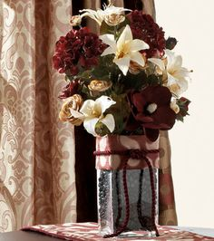 This would look pretty in the guest room.  Burgundy & Cream Floral Decor