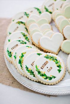 Hand-Painted Cookie Favor. Whether they're frosted to say your names or just a stack of pretty, freshly baked treats, your guests will love a few delicious cookies for a favor.