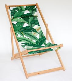 palms printed outdoor fabric on white oak folding chair outdoor furniture