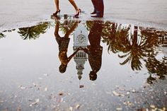 love the twist with the building on the typical 'puddle relfection' picture.