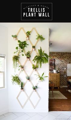 This DIY Leather and Wood Indoor Plant Trellis Wall adds such a gorgeous boho vibe and looks stunning in any entry way or any large wall! | Vintage Revivals #diyhomedecor #plantlady