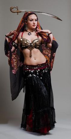 bellydance sword - while i'm 90% certain that this is Irina-Bellydancer Akulenko though it looks like a local dancer that i know as well... either way i've always loved this photo