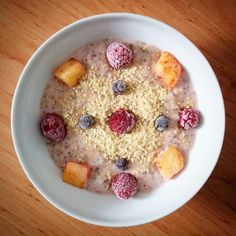 Strawberry protein oatmeal with chia seeds,wheat grem,raspberry,mango and blueberry