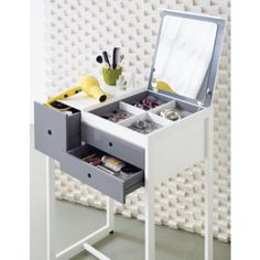 Modern Look: If you are a no frills type of person, look for a vanity with lots of organizational compartments like this CB2 Top Box Vanity ($399). The flip top mirror reveals four compartments to store all of your vanity essentials, while the side drawer is large enough to house your larger items like a blow dryer.