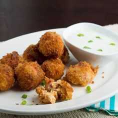 """Fried Pimiento Cheese Balls with Bacon.  """"Hot, gooey fried cheese balls with a crispy coating, studded with bacon and dipped in a creamy buttermilk ranch dressing.""""  //  by spicysouthernkitchen.com"""