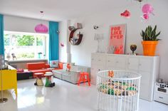 I love the bright pops of color against the white, as well as the awesome circular crib!