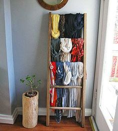 Draped scarves over ladder for storage