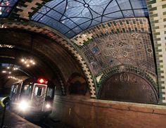 Love this place - City Hall subway station. If you ride the 6 train to the end of the line and get off at the Brooklyn Bridge stop, you're missing out on something incredible. As the train loops around to go back uptown, it passes through an abandoned and beautifully preserved City Hall station from 1904.