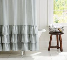 Ruffle Shower Curtain | Pottery Barn    I bet I could make something like this...maybe muslin on top, with the top ruffle burlap, the second ruffle lace, and the bottom ruffle another layer of burlap. What do you think? Would it be cute??