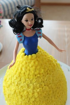 Princess Doll Cake, Sleeping Beauty maybe? Could you put Hello Kitty in a ball gown?? ;)
